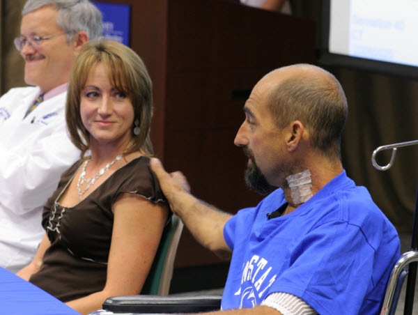 Transplant patient and donor at press conference