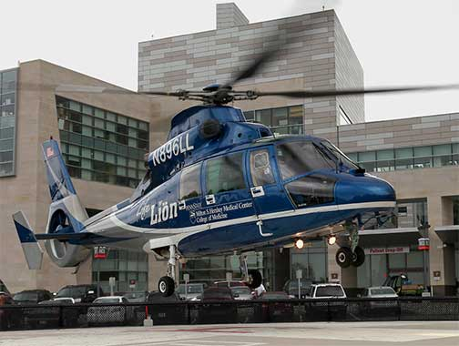 A photo of Penn State Health Milton S. Hershey Medical Center Life Lion helicoptor taking off from Hershey Medical Center's emergency helipad.