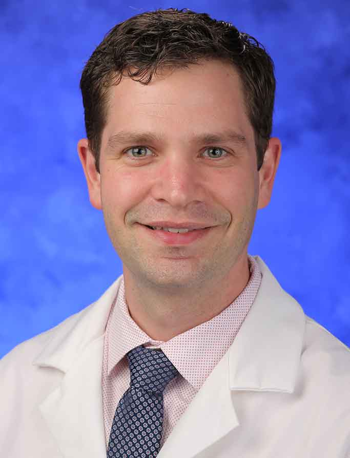 A head-and-shoulders photo of Darrin Bann, MD
